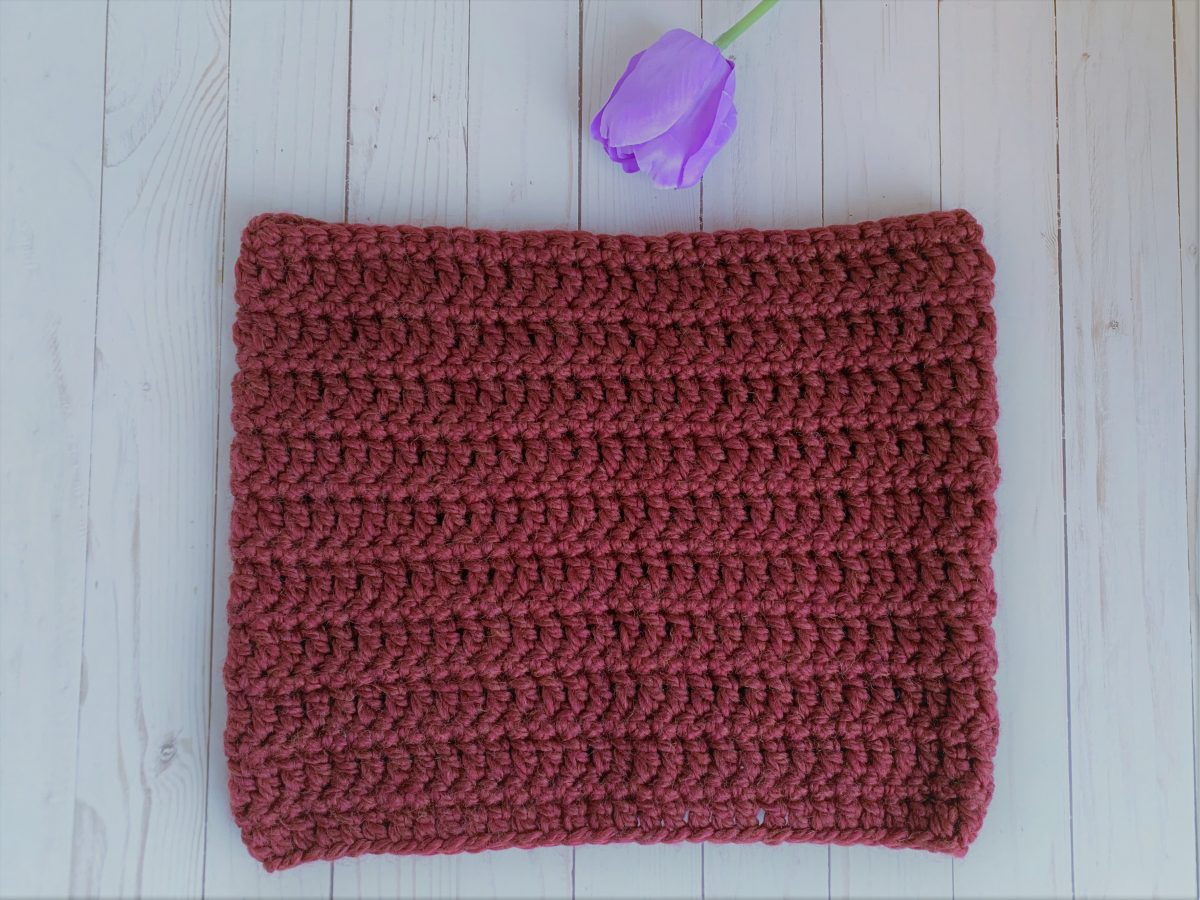 Garnet Cowl with a purple tulip to side